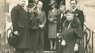 Sir Osbert Sitwell (extreme left), Queen Mary (extreme right) and others c 1943