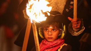 A child takes part in the festivities during the parade in Lewes, in East Sussex.