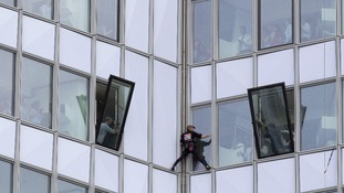 French urban climber Alain Robert, known as 'Spiderman', climbing up the 231 meter high (758 feet) First Tower