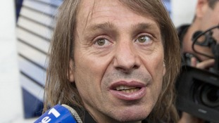 French urban climber Alain Robert, known as 'Spiderman', speaks to reporters after climbing up the 231 meter high (758 feet) First Tower