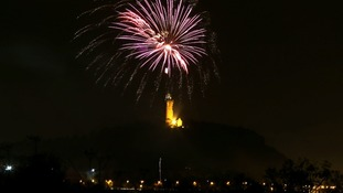 A firework display on Bonfire Night above the Wallace Monument near Stirling.