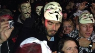 Russell Brand pictured with an Anonymous mask during the Million Mask March.