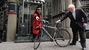 Boris Johnson holding a bike