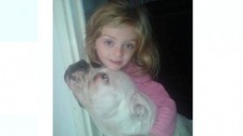 Lexi with the dog that is believed to have attacked her.