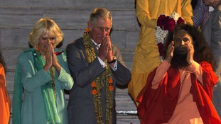 The Prince and Duchess on the banks of the Ganges.