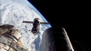 The Soyuz spacecraft prepares to dock with the International Space Station.