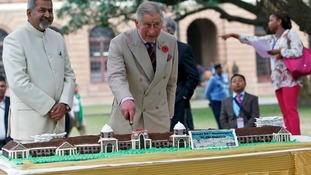 Prince Charles cut a giant cake made in the form of the Forest Research Institute building in Dehradun.