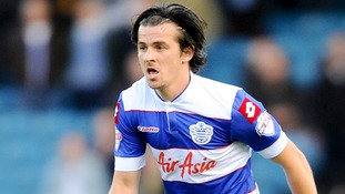 A man has been charged after a bottle was thrown at footballer Joey Barton during a match.