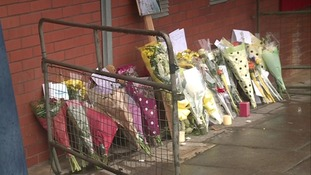 Tributes outside Luton police station