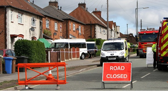 Victory Road in Derby is closed after five children die in a fire