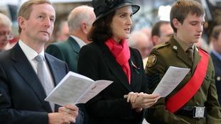 Irish Taoiseach Enda Kenny (left) and Northern Ireland Secretary of State Theresa Villiers at the war memorial in Enniskillen.