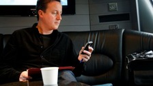 David Cameron texting in May 11 2010