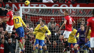 Robin van Persie (left) scores for Manchester United from a header.
