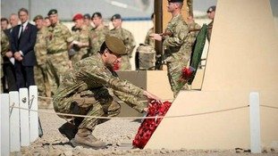 Soldiers of 7th Armoured Brigade The Desert Rats in Helmand province of Afghanistan pay their respects.