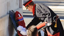 Prince Harry lays a wreath at the Cenotaph memorial in Whitehall.