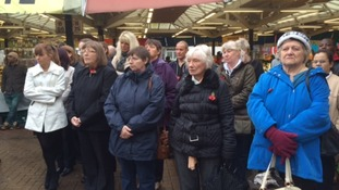 Shoppers in Leicester observe the two minute silence