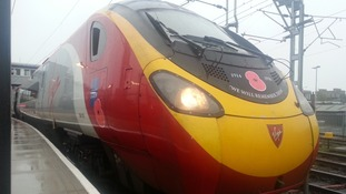 "This Virgin train has ""We will remember them"" printed on the front"