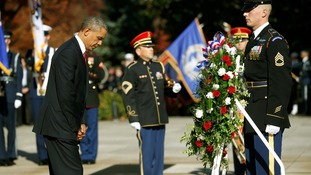 US President Barack Obama laid a wreath at the Tomb of the Unknowns.