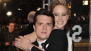 Jennifer Lawrence and Josh Hutcherson strike an unconventional pose at the premiere of Hunger Games: Catching Fire.