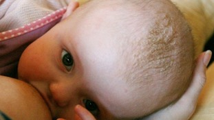 A baby being breastfed.
