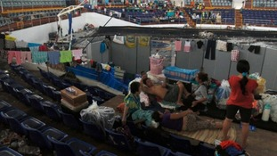 Typhoon victims make camp inside the Tacloban City Convention Centre