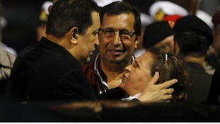 Venezuela's President Chavez greets his mother and brother upon arriving from Cuba at Simon Bolivar airport in Caracas