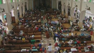 The pews of a Catholic Church in central Tacloban are being used as hospital beds