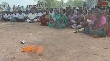 A group of Tamils sitting on the ground in protest in Sri Lanka.