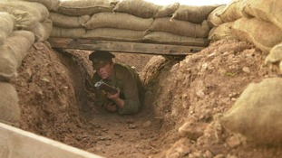 soldier in trench