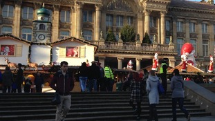 Shoppers in Victoria Square head to the opening day of the German Market