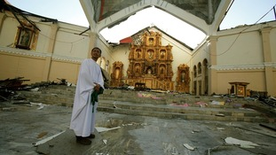 Catholic priest Father Martin stands in the destroyed Metropolitan Cathedral in the central Philippine city of Palo