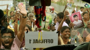 Tamil protesters hold up the Prime Minister's motorcade
