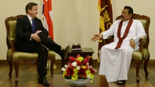 Prime Minister and David Cameron and Sri Lanka's President Mahinda Rajapaksa