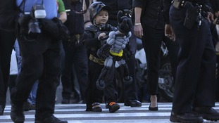 Miles carries his Batman balloon after the event.