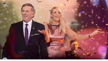 BBC Children in Need 2013 presenters Sir Terry Wogan and Tess Daly.