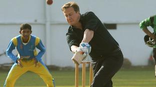 David Cameron faces the bowling of Sri Lankan cricketer Muttiah Muralitharan