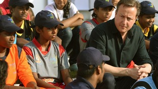 David Cameron chats to youngsters at the charity run by Muttiah Muralitharan