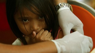 A girl receives a Tetanus immunity injection at a church that became a homeless shelter in Tacloban.