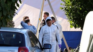 Forensics experts outside the home in Audley Drive, in Warlingham, Surrey.