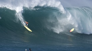 Surfer Greg McNamara broke the Guiness World Record for surfing a 78-foot wave