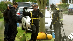 The marine diving team during the operation to remove the remains of an adult from a well in a graden in Surrey