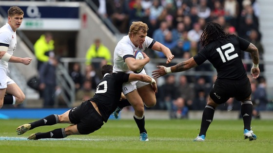 England centre Billy Twelvetrees charges into the All Blacks back-line.