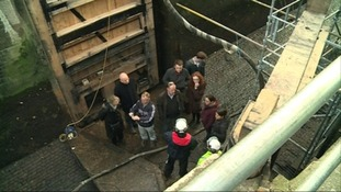 A tour group explores the lock