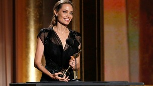 Angelina Jolie receives the Jean Hersholt Humanitarian Award at the 2013 Governors Awards.
