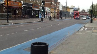 One side of Clapham High Street was cleaned, the other side was left dirty.