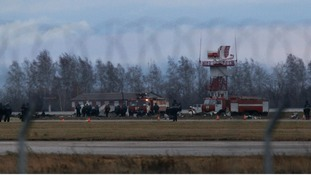 Investigators and Russian Emergencies Ministry members work at the site of the crash.