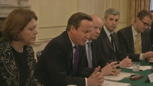 Prime Minister David Cameron addresses a Downing Street summit.