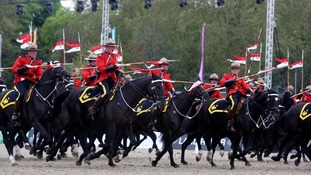 The Royal Canadian Mounted Police perform for Queen Elizabeth II at the Royal Windsor Horse Show at Windsor Castle, Berkshire