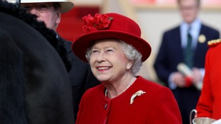 Queen at Windsor in red hat