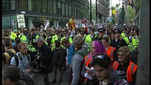 Occupy London supporters march through the City
